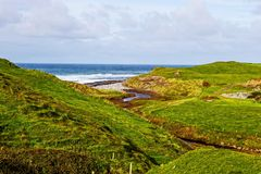 View at Cliffs of Moher from Doolin, Ireland. View over the rolling hills at Cliffs of Moher from Doolin, Ireland royalty free stock photo