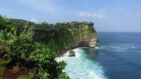 View from cliffs near Uluwatu temple. Sea view from cliffs near Uluwatu temple stock video