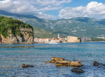 View of the cliffs and the old town of Budva. Royalty Free Stock Photo