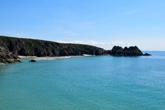 View from the cliffs at Porthcurno, Cornwall, England. View from the cliffs at Porthcurno beach, Cornwall, England on a sunny day stock photo