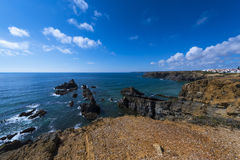 View of the cliffs and sea around the village of Zambujeira do Mar in Alentejo, Portugal Stock Photography