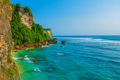 View of the cliffs and the sea in Bali. Indonesia. Uluwatu, Pantai Suluban. Beautiful view of a cliff and the sea in Bali Indonesia. Uluwatu, Pantai Suluban Stock Photo