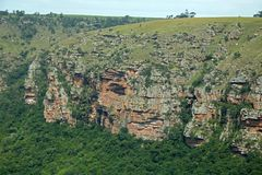 RUGGED CLIFFS ON FAR SIDE OF ORIBI GORGE. View of cliffs and vegetation on far side of Oribi Gorge canyon wall in Kwazulu Natal Royalty Free Stock Photo