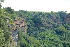 RUGGED CLIFFS IN ORIBI GORGE CANYON. View of cliffs and vegetation on far side of Oribi Gorge canyon wall in Kwazulu Natal Stock Image