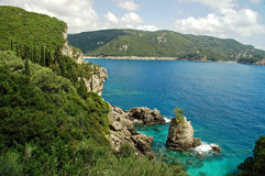 View of Cliffside Coastline on Greek Island Stock Photo