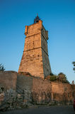 View of the clock tower made of stone and with a bell in Draguignan. Stock Photos
