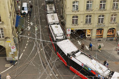View from the Clock Tower to the tram passing by the street in Bern, Switzerland. Stock Photos