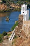 Clock tower Torre do Relogio on the right bank of Guadiana. Me Royalty Free Stock Photo