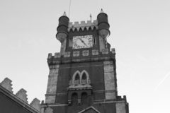 The view of the Clock tower with the turrets and battlements royalty free stock photography