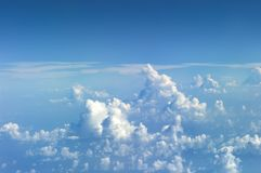 View at Clods on the Sky from the window of an aiplane. Skyscape viewed from airplane.  Stock Images