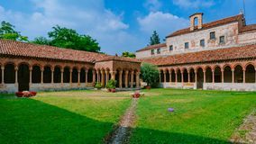 Cloister and garden of San Zeno Maggiore Basilica, a landmark Romanesque church in Verona, Italy stock photos