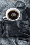 View close-up on black women`s gloves and coffee cup Stock Image