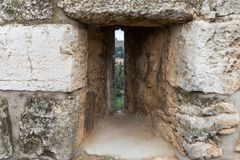 View through the closed loophole in the city`s fortress wall at the city near the Jaffa Gate in old city of Jerusalem, Israel royalty free stock images