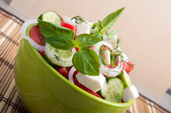 View closeup on a green bowl with a useful salad Stock Photo