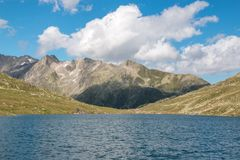 View closeup Marjelen lakes, scene in mountains, route great Aletsch Glacier. In national park Switzerland, Europe. Summer landscape, sunshine weather, blue sky stock photos