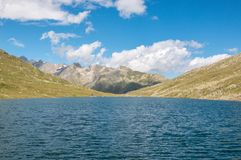 View closeup Marjelen lakes, scene in mountains, route great Aletsch Glacier. In national park Switzerland, Europe. Summer landscape, sunshine weather, blue sky royalty free stock photography