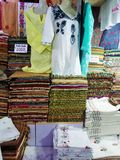 View of a clothes and folded shawls. Headscarves may be worn for a variety of purposes, such as protection of the head or hair from rain, wind, dirt, cold stock photo