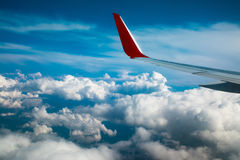 View of cloud sky and wing of airplane Royalty Free Stock Images