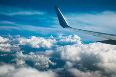 View of cloud sky and wing of airplane Stock Images