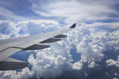 View of cloud with wing of airplane from window Stock Images