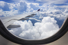 View of cloud with wing of airplane from window royalty free stock images