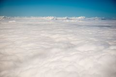 View above clouds from an airplane Royalty Free Stock Image
