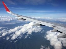 View of clouds from the airplane.Aerial view of cloud and blue sky with wing`s airplane. Royalty Free Stock Image