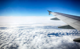 View of clouds from a airplane window Royalty Free Stock Photo