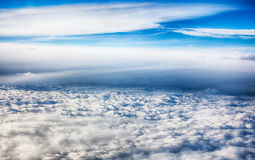 View of clouds from a airplane window. Royalty Free Stock Photography