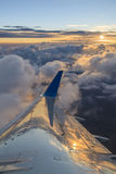View of the clouds and airplane wing Stock Image