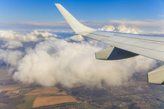 View of the clouds and airplane wing Stock Photos
