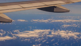 View Clouds Azure Sea under Airliner Wing stock video footage