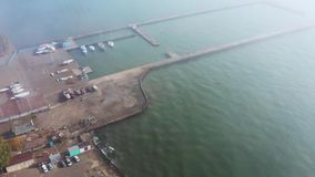 View through the clouds at the marina. Shot from a bird`s eye view stock footage