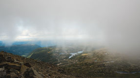 View from the clouds. Picture taken on the way up to the top of Gaustatoppen in Rjukan, Norway Stock Photo