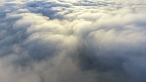 View of the clouds from the plane. Flying over earth stock video