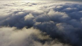 View of the clouds from the plane. flying over earth stock video footage