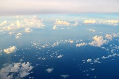 View of clouds from plane window Stock Photo