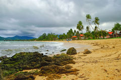 View of cloudy evening at tropical beach Royalty Free Stock Photo