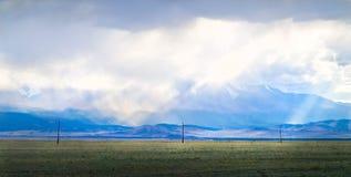 View of cloudy peaks of Tavan-Bogdo-Ula mountain ridge Royalty Free Stock Image