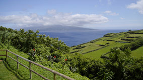 The view of cloudy Pico island. Azores. Stock Photo