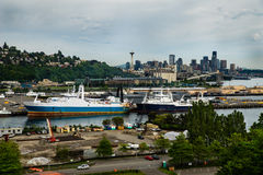 View of cloudy Seattle skyline and shipping port from the Magnolia bridge Royalty Free Stock Photos