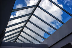 View of the cloudy sky through the glass roof Royalty Free Stock Images