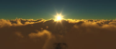 View of a cloudy sunrise while flying above the clouds. Stock Photo