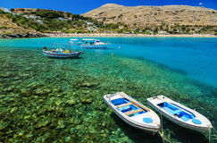 View of the coast with boats in Lindos bay, Greece Royalty Free Stock Photos