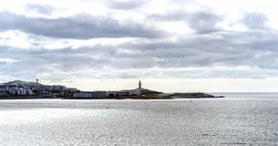 View of the coast of the city of La Coruna on the coast of Galicia (Spain). On the right the lighthouse called 'Torre de Hercules stock photos