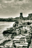 View of the coast fishermen settlement and the Siege Bell War Memorial in Valletta Stock Images