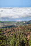 View of the coast of the island of Tenerife and clouds over the sea from the height of the ridge. Canary Islands, Spain Royalty Free Stock Images