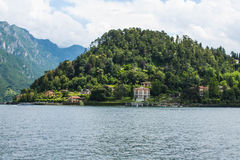 View on coast line of Lake Como, Italy, Lombardy region. Italian landscape, with Mountain and city with many colorful buildings on Stock Image