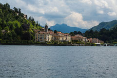 View on coast line of Lake Como, Italy, Lombardy region. Italian landscape, with Mountain and city with many colorful buildings on Royalty Free Stock Images