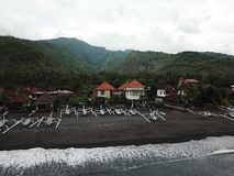 View of the coast and mountains in Amed in the eastern part of Bali. Amed is the original fishing village. stock images